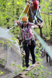 Woman at adventure park in forest Royalty Free Stock Photography