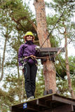 Woman in an adventure park Royalty Free Stock Photography