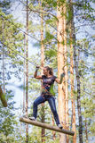 Woman in adventure rope park Stock Image