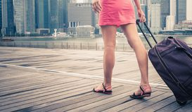 Woman adventure to Singapore. Tourist or woman adventure with luggage in Singapore Stock Photos