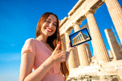 Woman advertising Acropolis Stock Photos