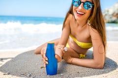 Woman advertising suntan cream Stock Photography