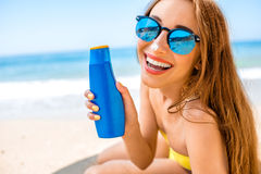 Woman advertising suntan cream Royalty Free Stock Photography