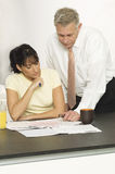 Woman With Advisor In Office Royalty Free Stock Photography