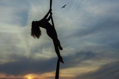 Woman aerial acrobat dances in the air. Stock Photo