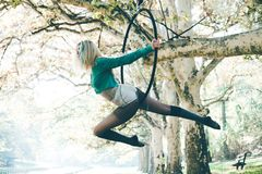 Woman aerial hoop  dance in forest Stock Photography
