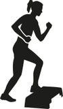 Woman aerobic exercise step Royalty Free Stock Photo