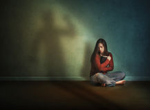 Woman afraid and alone Stock Images