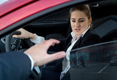 Woman afraid of burglar trying to break into the car Stock Image