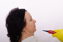 Woman fearing at suspicious cosmetic jab Stock Photo
