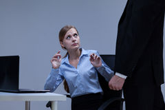Woman is afraid of her boss. In the office stock photo