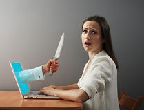 Woman afraid virtual maniacs Stock Image