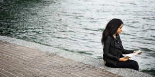 Woman African American Depressive Sad Female Concept. Young woman sitting depressive near the river Stock Images
