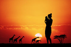 Woman in African landscape at sunset. Illustration of woman in African landscape at sunset Royalty Free Stock Photo