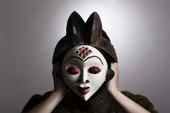 Woman with African mask Stock Photos