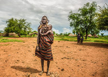 Woman from the african tribe Mursi with  her baby, Ethiopia Royalty Free Stock Photo