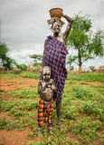 Woman from the african tribe Mursi with her baby, Ethiopia royalty free stock photos