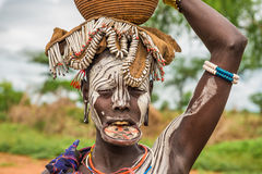Woman from the african tribe Mursi, Omo Valley, Ethiopia. OMO VALLEY, ETHIOPIA - MAY 7, 2015 : Woman from the african tribe Mursi with big lip plate in her Royalty Free Stock Images