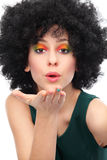 Woman with afro blowing a kiss Stock Photos