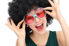 Woman with afro and glasses. Woman wearing wig over white background Stock Photography