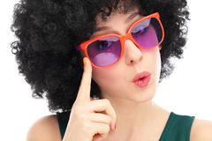 Woman with afro and glasses. Woman wearing wig over white background Stock Image