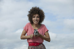 Woman with afro hair with vintage camera Royalty Free Stock Images