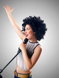 Woman with afro haircut against gradient Stock Photo
