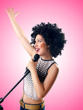 Woman with afro haircut against gradient Stock Images
