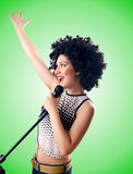 Woman with afro haircut against gradient Royalty Free Stock Photo