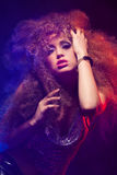Woman with afro haircut is dancing disco Royalty Free Stock Photo