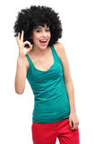 Woman with afro showing OK sign Royalty Free Stock Image
