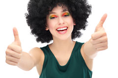 Woman with afro showing thumbs up Stock Photo