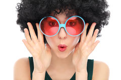 Woman with afro and sunglasses. Woman wearing wig over white background Royalty Free Stock Photography