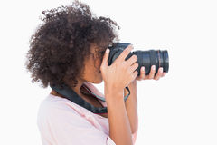 Woman with afro taking a photo Royalty Free Stock Photo