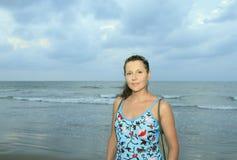Woman again storming sea Stock Image