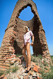 Woman against abandoned ruins Stock Image