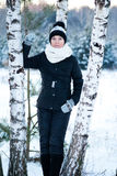Woman against a birch Stock Images