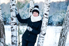 Woman against a birch Stock Photography