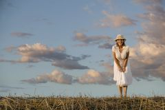 Woman Against a Cloudy Sky Royalty Free Stock Image