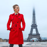 Woman against Eiffel tower in Paris, France looking aside Royalty Free Stock Images
