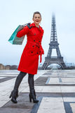 Woman against Eiffel tower in Paris, France with shopping bag Royalty Free Stock Images