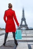 Woman against Eiffel tower in Paris, France with shopping bag Royalty Free Stock Image