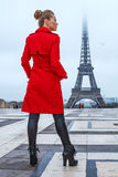 Woman against Eiffel tower in Paris looking into distance Stock Image