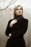 Fashion woman against a foggy autumn nature Royalty Free Stock Image
