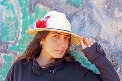 Woman against a graffiti background Stock Photo