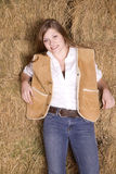 Woman against hay smiling Stock Photo