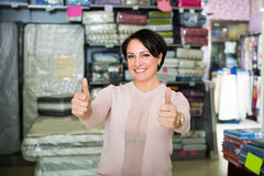 Woman against interior of textile store Royalty Free Stock Image