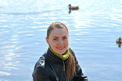 Woman against lake Stock Photo