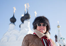 Woman  against orthodoxy domes. Mature woman in wintry clothes against orthodoxy domes at Murom, Russia Stock Photography