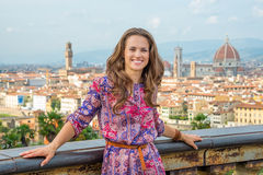 Woman against panoramic view of florence, italy. Portrait of happy young woman against panoramic view of florence, italy Stock Photo